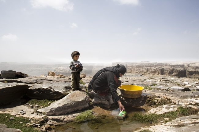A mother collects water collected in the rocks after the rain. The family doesn't have any water well and totally relies on rain water to survive. Yemen is enduring a water crisis that ranks among the worst in the world. Photo by Matilde Gatton, @matildegattoni