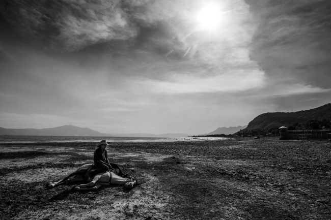 A horse rider sitting on his horse in a dry section of Mexico's biggest lake which has been hit by a severe drought. Photo by Bernardo Deniz, @bernardodeniz